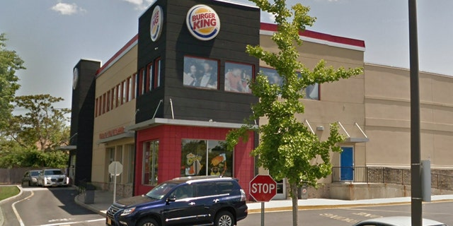 Police say the attack happened behind this Burger King restaurant in Huntington Station, N.Y.