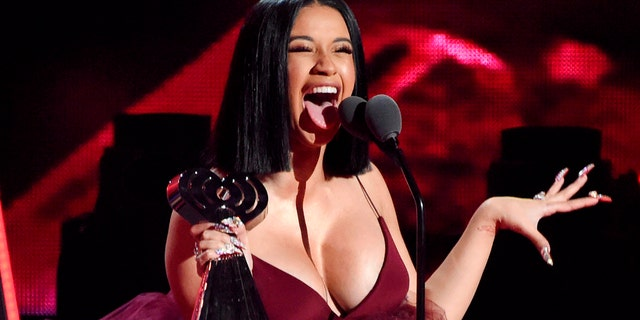 In this March 11, 2018, file photo, Cardi B accepts the Best New Artist award during the 2018 iHeartRadio Music Awards in Inglewood, Calif.