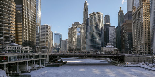Ice covers the Chicago River Wednesday, Jan. 30, 2019, in Chicago as a deadly arctic deep freeze enveloped the Midwest with record-breaking temperatures. (AP Photo/Teresa Crawford)