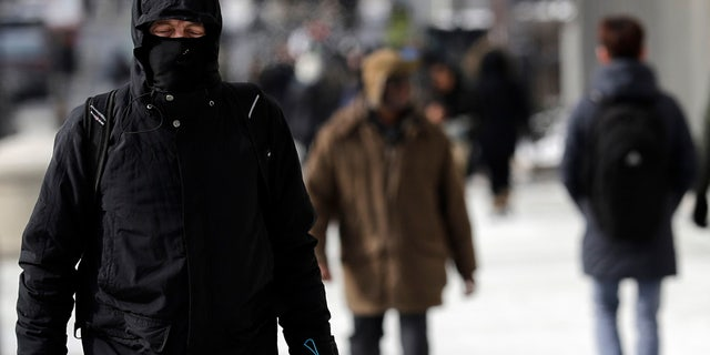 A man is bundled up against the cold in downtown Chicago, Sunday, Jan. 27, 2019.