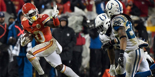 Kansas City Chiefs wide receiver Tyreek Hill (10) gestures as he runs past Indianapolis Colts safety Clayton Geathers (26) and linebacker Anthony Walker during the second half of an NFL divisional football playoff game in Kansas City, Mo., Saturday, Jan. 12, 2019. (Associated Press)