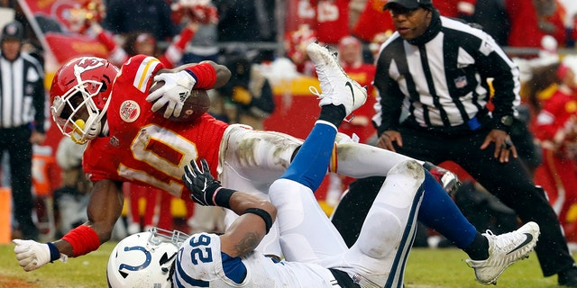 Kansas City Chiefs wide receiver Tyreek Hill (10) scores a touchdown past Indianapolis Colts safety Clayton Geathers (26) during the first half of an NFL divisional football playoff game in Kansas City, Mo., Saturday, Jan. 12, 2019. (Associated Press)