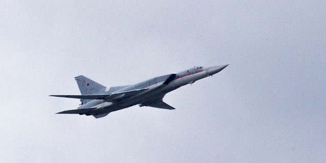 FILE - In this Thursday, May 5, 2016 file photo, a Russian Tu-22 bomber flies over Moscow's Kremlin during a general rehearsal for the Victory Day military parade which will take place at Moscow's Red Square on May 9 to celebrate 71 years after the victory in WWII in Moscow, Russia. The Russian military says that one of its long-range bombers has crash-landed in the Arctic, Tuesday Jan. 22, 2019, killing two of its crew of four. (AP Photo/Ivan Sekretarev, File)
