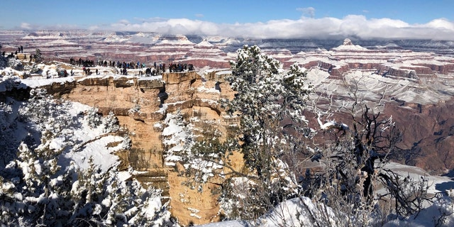 In this Tuesday, Jan. 1, 2019, photo, snow covers the Grand Canyon in Arizona.