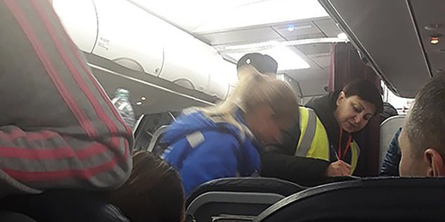 At least five passengers reported feeling ill during the flight.