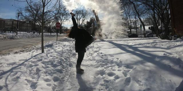 """A woman participates in the """"Boiling Water Challenge"""" in Evanston, Illinois."""