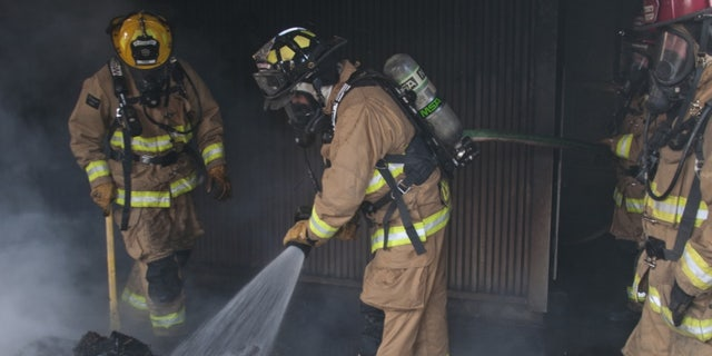 104th Civil Engineering Squadron firefighters conduct live structural fire training Nov. 27, 2018, at Barnes Air National Guard Base, Massachusetts.