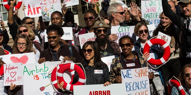 Supporters of Airbnb hold a rally on the steps of New York City Hall showing support for the company on October 30, 2015 in New York City. The New York City council is currently debating how to regulate the controversial company.