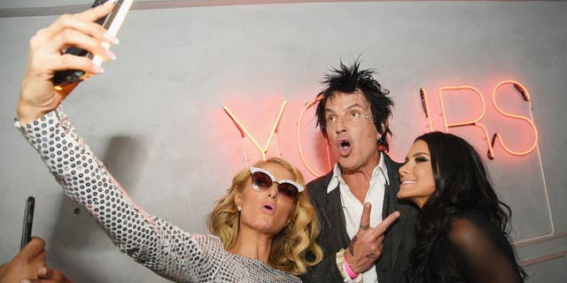 Paris Hilton, Tommy Lee and Brittany Furlan attend the 2018 Tribeca Film Festival World Premiere of Bert Marcus' The American Meme' in 2018.(Dimitrios Kambouris/Getty Images for Bert Marcus Productions)