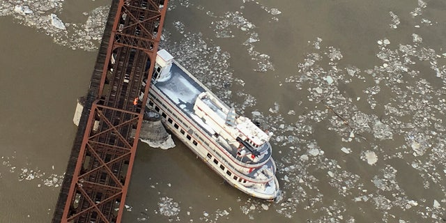 The Captain JP III cruise ship is wedged against the Livingston Avenue train bridge that spans the Hudson River, Friday, Jan. 25, 2019 in Albany, N.Y.
