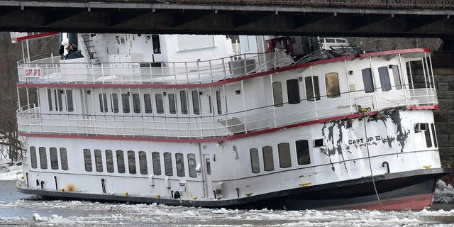 Captain JP III cruise ship is wedged against the Livingston Avenue train bridge that spans the Hudson River in Albany, N.Y., Friday, Jan. 25, 2019.