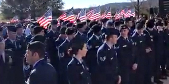 """The crowd at """"unaccompanied"""" veteran Joseph Walker's funeral in Texas included an Air Force unit from Fort Hood."""