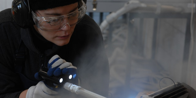 Margrit Bormann during conservation of a metal element from one of the crematoria