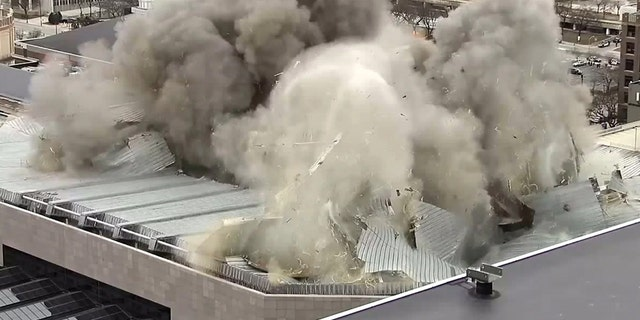 Detonation charges brought down the roof of the Bradley Center in Milwaukee on Sunday.