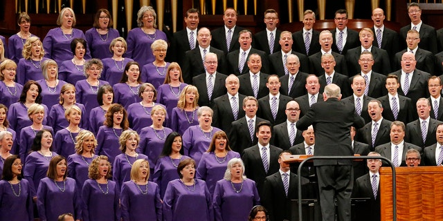 FILE - In this Oct. 6, 2018 file photo, female and male members of The Tabernacle Choir perform during the twice-annual conference of The Church of Jesus Christ of Latter-day Saints in Salt Lake City. (AP Photo/Rick Bowmer, File)