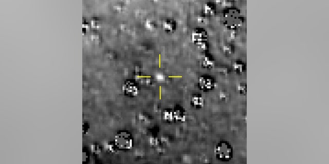 """FILE - This composite image made available by NASA shows the Kuiper Belt object nicknamed """"Ultima Thule,"""" indicated by the crosshairs at center, with stars surrounding it on Aug. 16, 2018, made by the New Horizons spacecraft. (NASA/Johns Hopkins University Applied Physics Laboratory/Southwest Research Institute via AP)"""