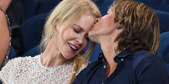 Nicole Kidman and Keith Urban share an affectionate moment as they attend the 2019 Australian Open at Melbourne Park on Jan. 24, 2019 in Melbourne, Australia.