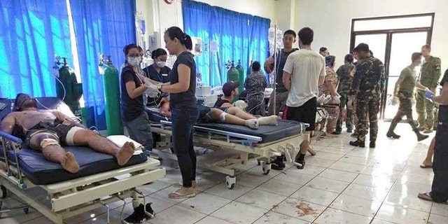Bomb victims are treated in a hospital after two bombs exploded in front of a Roman Catholic cathedral in Jolo, the capital of Sulu province in the southern Philippines, where militants are active. Sunday, January 27, 2019. (WESMINCOM Philippines Armed Forces Over AP)
