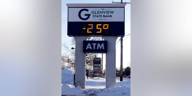 A sign shows the current outdoor temperature in Glenview, Ill., Wednesday, Jan. 30, 2019.