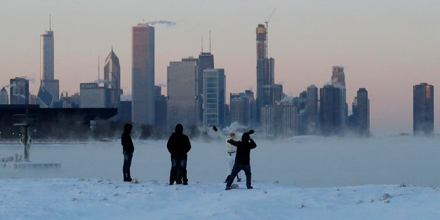 A deadly arctic deep freeze enveloped the Midwest with record-breaking temperatures on Wednesday, triggering widespread closures of schools and businesses, and prompting the U.S.