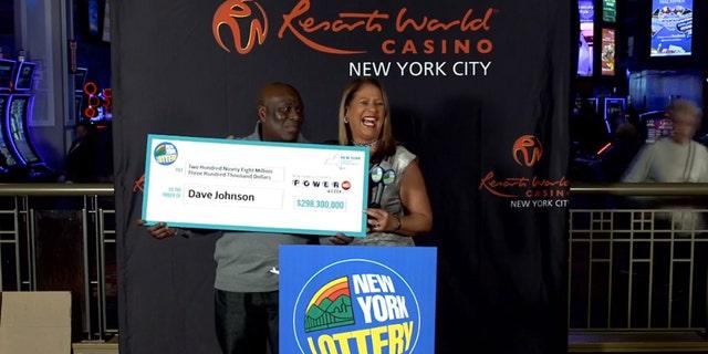 Powerball winner DavidJohnson collects his prize. (New York Lottery)