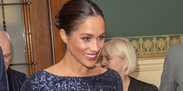 Meghan Markle sports a dark pedicure for date night with Prince Harry in January 2019.