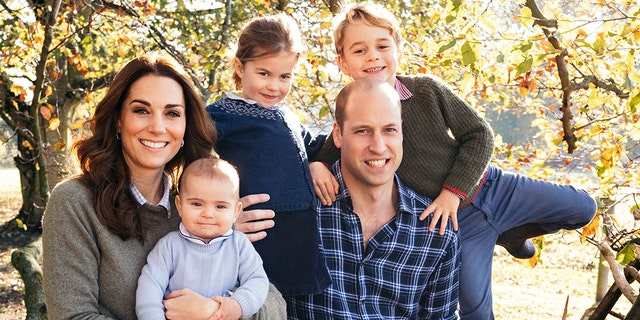 Kate Middle and Prince William pose for a photo with their three children, George (right), Charlotte (middle) and Louis.