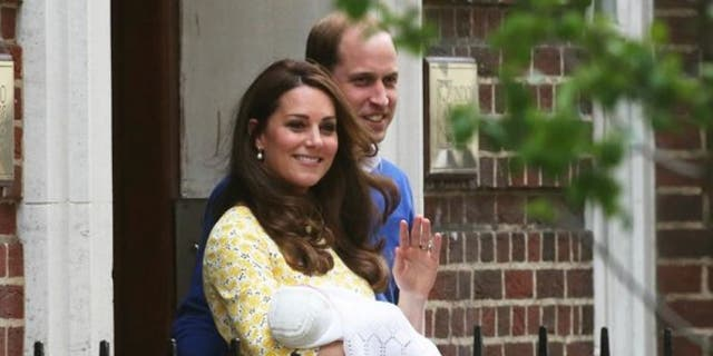 Prince William and his wife Catherine, Duchess of Cambridge, appear with their baby daughter Charlotte outside the Lindo Wing of St Mary's Hospital.