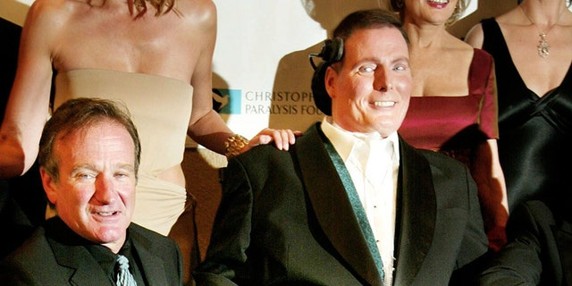 Christopher Reeve with pal Robin Williams. — Reuters