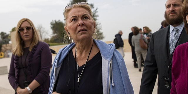 In this Sunday, Jan. 27, 2019 photo, US actress Roseanne Barr visits the Yad Vashem Holocaust memorial in Jerusalem.