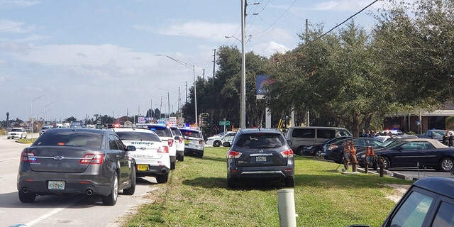 Florida law enforcement responded to a bank Wednesday afternoon after a suspect claimed to dispatch that he'd opened fire inside, authorities said.