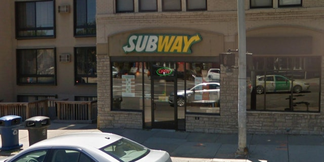 A Subway employee in Michigan was photographed with her bare feet on the counter near the food.