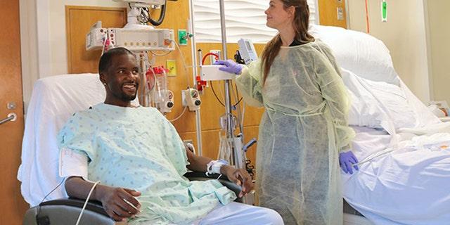 Daru Smith has vitals checked after undergoing a triple-organ transplant.