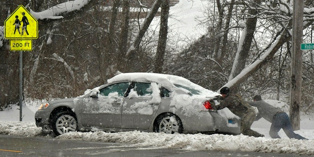 Multiple deaths on snow-slicked roads were reported in the Midwest as a winter storm swept the region this weekend, snarling traffic in several states and leaving thousands without power.