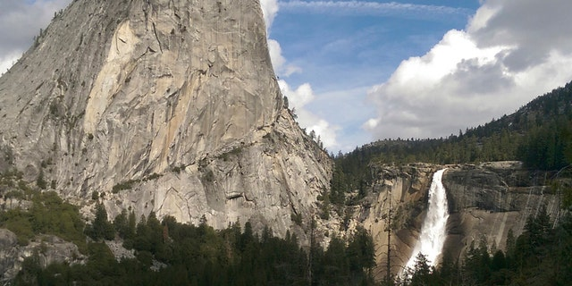 In this March 28, 2016, file photo provided by the National Park Service, water flows over the Nevada Fall near Liberty Cap as seen from the John Muir Trail in Yosemite National Park, Calif.