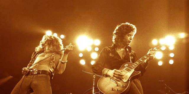 Robert Plant, left, and Jimmy Page performing live onstage (Photo by Robert Knight Archive/Redferns)
