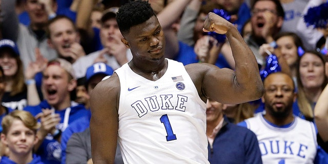 Duke's Zion Williamson (1) reacts following a basket against Virginia during the first half of an NCAA college basketball game in Durham, N.C., Saturday, Jan. 19, 2019. (AP Photo/Gerry Broome)