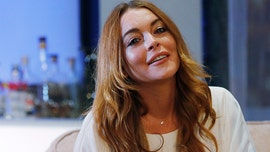 Lindsay Lohan says she's dropping an album in February