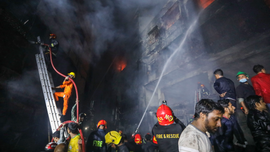The Latest: Death toll in Bangladesh fire lowered to 67