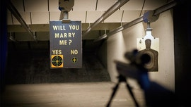 Hunting enthusiast proposes to girlfriend with custom target at shooting range