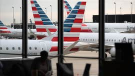 13 American Airlines passengers hospitalized after flight to Boston
