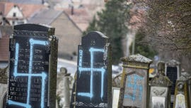 Jewish graves desecrated in France as people hit streets to combat 'poison' of anti-Semitism