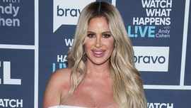 Kim Zolciak-Biermann responds to critic who said her 'photoshopping is out of control' on swimsuit photo
