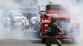 Guaido's trucks clash with Maduro's military in attempt to force aid into Venezuela