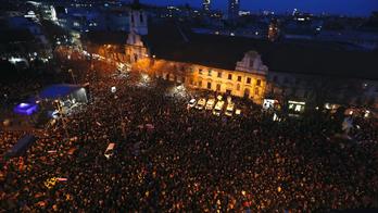 Slovaks mark anniversary of slayings of journalist, fiancee