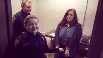 Girl fighting leukemia becomes honorary cop in Georgia