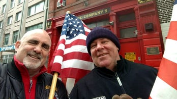 Retired 9/11 first responders honor vandalized American flag in New York City