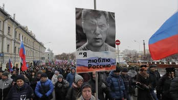 Thousands march in memory of slain Russian opposition leader Nemtsov