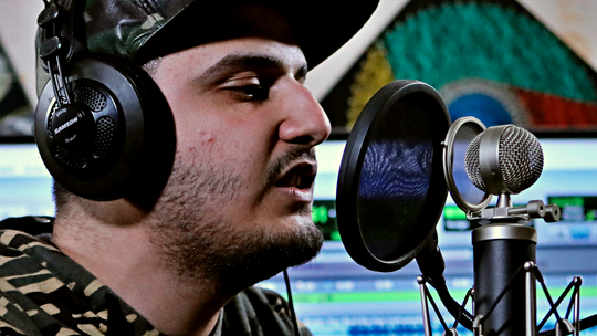 Iraqi rapper gives angry youth in city of Basra music outlet