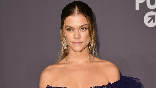 Nina Agdal shows off impressively toned legs, arms in purple bikini during beach run